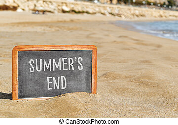 text summers end in a chalkboard on the beach
