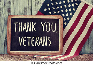 text thank you veterans in a chalkboard and the flag of the...