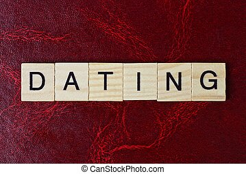text the word dating from gray wooden small letters with ...