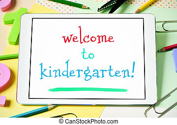 text welcome to kindergarten in a tablet - closeup of a ...