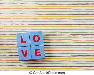 text wooden blocks spelling the word love alphabet