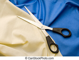 Textile background and scissors