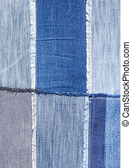 patchwork from various blue denim flaps close up