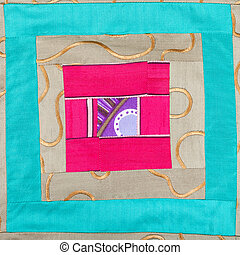 square decor of patchwork cloth