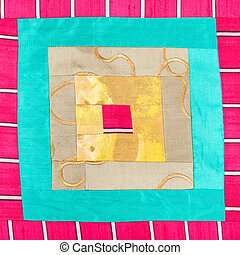 square pattern of patchwork cloth