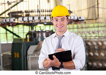 textile factory manager portrait in production area