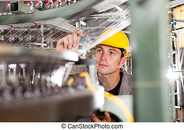 textile factory quality controller checking yarn