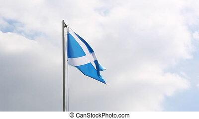 Textile flag of Scotland on a flagpole