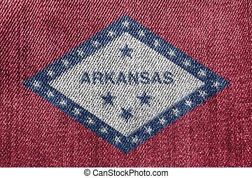 Textile Industry Or Politics Concept: Arkansas Flag Denim Jeans Background