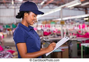 textile, qualité, contrôleur, écriture, sur, presse-papiers