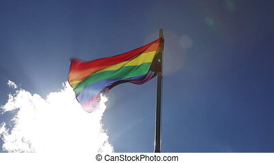 Textile rainbow flag on a flagpole