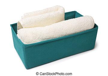 Textile storage box with bath towel