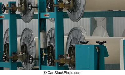 textile yarn processing shop - machine evaporates textile...