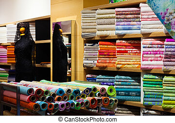 interior of fabric shop - textiles for sale in interior of...