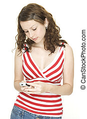 Texting - A young woman sends a text message from a ...