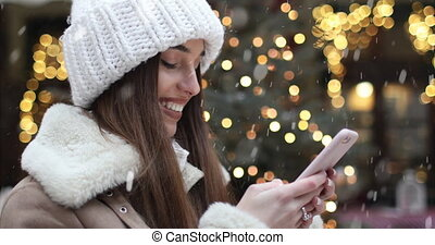 Texting Outdoor with Smartphone - Beautiful smiling girl...