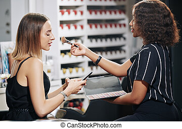 Texting woman in beauty salon