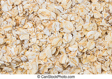 texture background Heap of rolled oats. Closeup. Top view