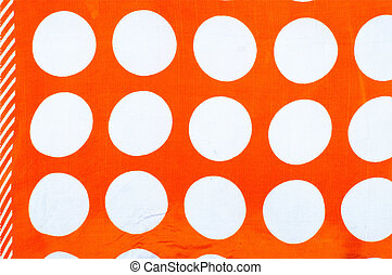 Texture, background.  mustard-colored fabric with white circles