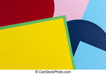 Texture background of fashion papers in memphis geometry style. Yellow, blue, green, red and pastel pink colors. Top view, flat lay