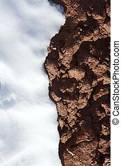 texture contrast snow and red clay mud soil