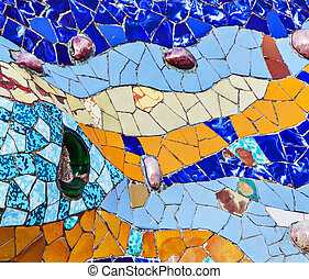 mosaic of colored ceramic tile by Antoni Gaudi at his Parc Guell, Barcelona, Spain