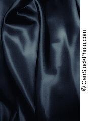 texture of a dark blue silk