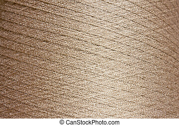 Texture of a large bobbin of thread