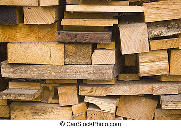 Texture of a pile of dry chopped firewood as a background for wallpaper.