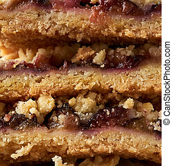 texture of baked plum crumble cake, full frame, close up