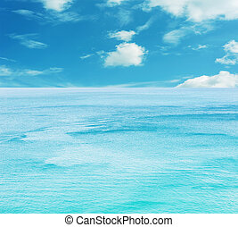 Texture of blue sea water and sky