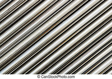 Texture of chrome steel pipe sort in diagonal, abstract background