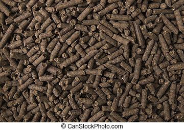 Texture of compressed organic fertilizer.