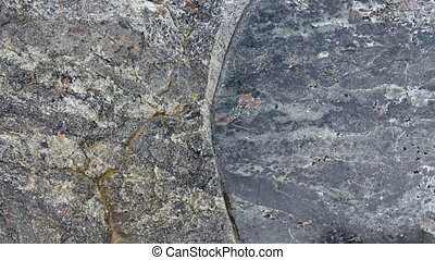 Texture of cracked raw gray stone