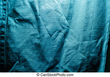 texture of crumpled blue jeans