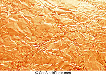 Texture of crumpled metal gilded foil - The texture of...