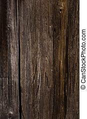 Texture of dark brown wooden surface
