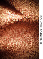Brown leather texture background closeup. Folds wavy natural skin material