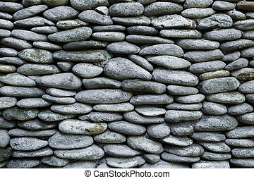 Texture of gray pebble stone wall background