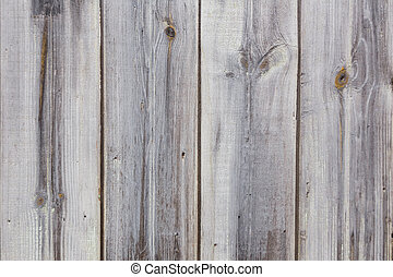 Texture of gray wooden old fence boards