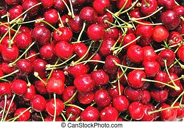 Texture of group of red ripe cherry
