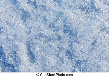 Texture of ice on the frozen lake. Blue color background.