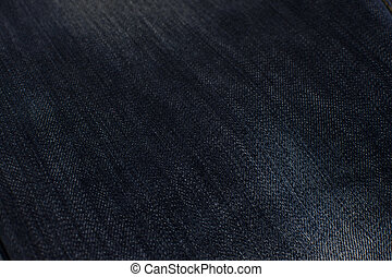 Texture of jeans dark close up, background.