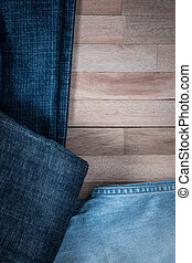 Texture of jeans on wooden background