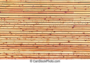 Texture of natural wooden lining made of pine wood planks.
