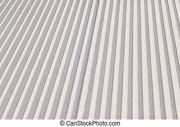Texture of new groomed snow on empty ski slope - Close-up...