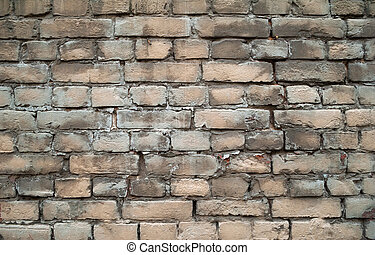 Texture of old gray brick wall with traces of plaster