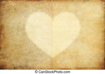 texture of old grunge paper with heart and copy space