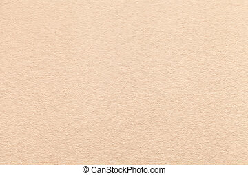 Texture of old light beige paper background, closeup....
