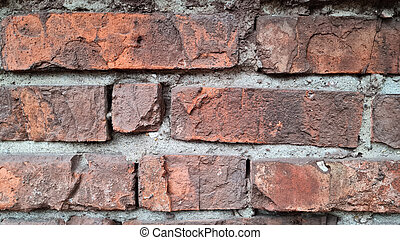 Texture of old red brick wall close-up.